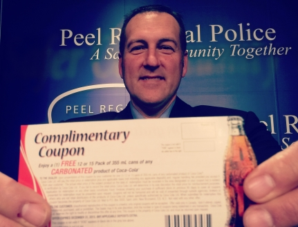 Coca-Cola Canada VP of field sales John Stiefelmeyer announces a partnership with Peel Regional Police for the 2015 festive R.I.D.E. campaign at police headquarters on Tuesday, Nov. 24, 2015. (Photo: Kelly Roche/QEW South Post)