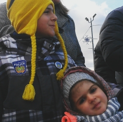 Gianluca, 7, and Ariana, 4 of Mississauga enjoy the festivities at the Santa Claus Parade in Streetsville. Photo: Kelly Roche/QEW South Post