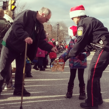 A man donates to the Toys for Tots campaign during the Santa Claus Parade in Streetsville. Photo: Kelly Roche/QEW South Post