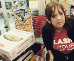 Laurie, a cash manager at the Meadowvale Canadian Tire, worked quickly to bag items as volunteers with the Salvation Army and Peel Regional Police shopped for youth ages 9 to 14 on Wed. December 16, 2015. (Photo: Kelly Roche/QEW South Post)