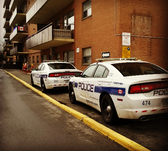 Peel Police guard the ground floor unit at 1051 Seneca Ave. in Port Credit, where a man was stabbed on Thursday, Dec. 31, 2015. (Photo: Kelly Roche/QEW South Post)
