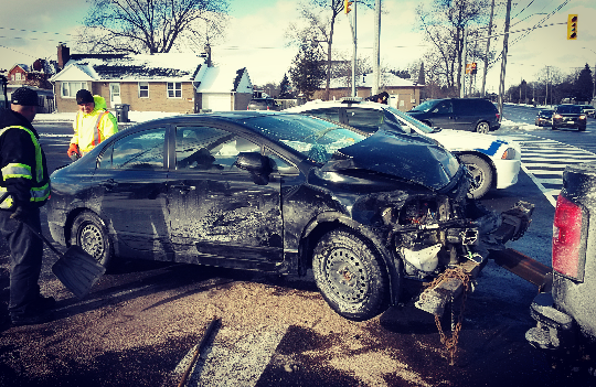 A paramedic vehicle was one of three involved in a crash at Tomken Rd. and Burnhamthorpe Rd. E. on Wednesday, Jan. 13, 2016. Minor injuries were reported and the intersection was cleared within an hour. (Photo: Kelly Roche/QEW South Post)