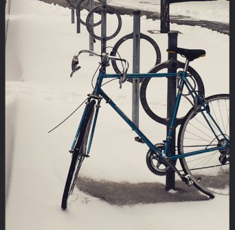 Snow and ice didn't stop one cyclist, whose bicycle was parked along Front St. in downtown Toronto on Tuesday, Jan. 12, 2016. (Photo: Monique Anglin/QEW South Post)