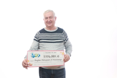 Bogdan Oleksyszak of Mississauga is celebrating a Christmas Day prize. (Photo: OLG)