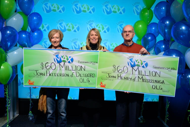 OLG's VP of lottery marketing and sales Wendy Montgomery hands out a record breaking $120 million in lottery prizing at one time at the OLG Prize Centre Wednesday, Feb. 24, 2016. John Henry of Mississauga won the Dec. 25, 2015 $60 million Lotto Max jackpot and Joan Patterson of Desboro won the Feb. 5, 2016 $60 million Lotto Max jackpot. (Photo: OLG)