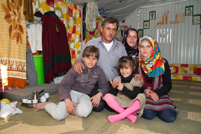 Fatima, 44,  Zakaria, 47, and their children Mohammed, 12, Laynor, 5, and Ghadeer 13, in their shelter in Azraq refugee camp. (Photo: World Vision Canada)