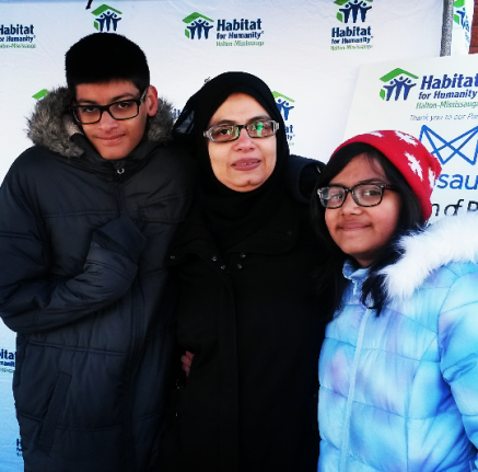 Asaad Shaikh, 14, mother Samina Khalid, and Uniba Shaikh, 11, are excited about moving into 5032 Mariner Ct. in Mississauga. A Habitat for Humanity build is about to begin. (Photo: Kelly Roche/QEW South Post)