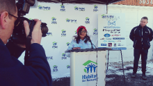 Uniba Shaikh, 11, makes a speech as Habitat for Humanity outreach manager Kevin Whyte looks on at 5032 Mariner Ct. in central Mississauga. A groundbreaking ceremony took place on Friday, Mar. 4, 2016. (Photo: Kelly Roche/QEW South Post)