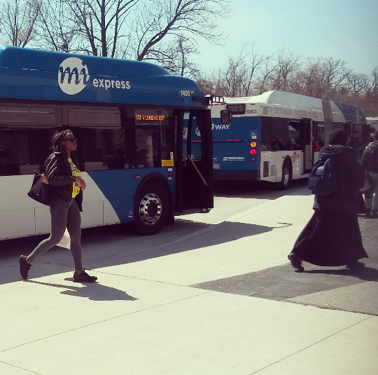 Students come and go from the bus terminal at the University of Toronto Mississauga on Friday, Apr. 15, 2016. A survey by StudentMoveTO finds 33 per cent of students spend two hours or more per day traveling to and from campus. (Photo: Kelly Roche/QEW South Post)