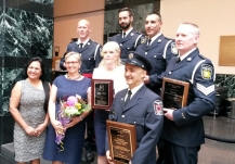 Volunteers and heroes were recognized at the 2016 Civic Awards reception at Mississauga City Hall on Thursday, May 26, 2016. Back row L-R: Peel Regional Police constables Paul Vreugdenhil, Tim Weatherley, Rob Schembri; Det. Shane McFadden. Front row L-R: Mississauga Real Estate Board president Asha Singh; volunteer Patricia Grady; volunteer Patricia Anderson; Mississauga firefighter Nelson Anastacio. (Photo: Kelly Roche/QEW South Post)