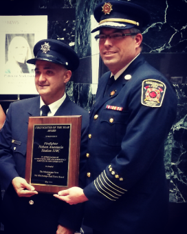 Mississauga Firefighter of the Year Nelson Anastacio poses with Fire Chief Tim Beckett at City Hall on Thursday, May 26, 2016. Anastacio is being recognized for raising funds for the Hospital for Sick Children to buy laptops, iPads, and infant mobiles for patients. (Photo: Kelly Roche/QEW South Post)