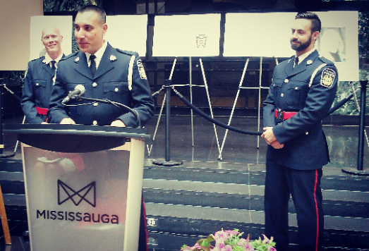 "Peel Regional Police constables Paul Vreugdenhil, Rob Schembri, and Tim Weatherley are winners of the Community Hero Award, presented at Mississauga City Hall on Thursday, May 26, 2016. The trio saved a fellow officer, Const. Ron Giles, in April 2015 after Giles was stabbed in the arm while responding to a mental health call. Giles was severely injured. ""As police officers, our number one goal is to serve our community, and this was an opportunity for us to actually help somebody who serves the community every day in a very admirable way,"" said Schembri. ""For us to be able to actually help Ron ... from a situation which could've prevented him from further serving the community, is an honour."""