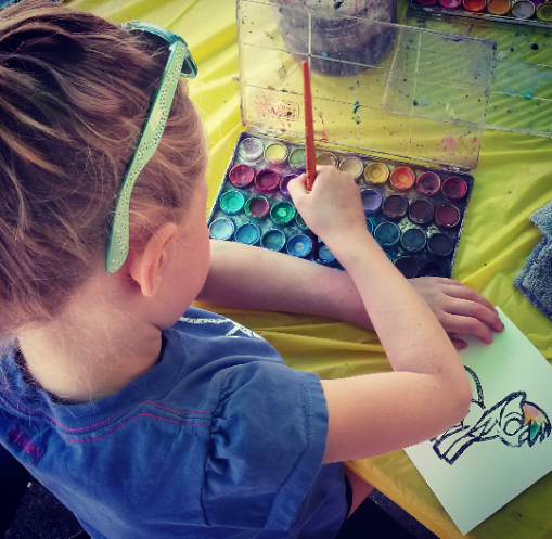 Madison, 7, paints at the 4Cats Arts Studio tent at the Port Credit Farmers' Market on June 4, 2016. (Photo: Kelly Roche/QEW South Post)