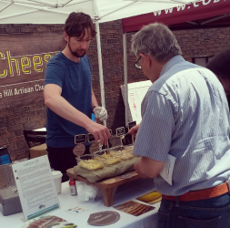 A visitor sampled the offerings at Good Cheese Co. as the Port Credit Farmers' Market opened Saturday, June 4, 2016, at the corner of Lakeshore Rd. E. and Elmwood Ave. N. (Photo: Kelly Roche/QEW South Post)