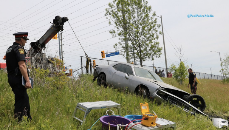 A Dodge Charger was pulled from a pond after its driver notified Peel Police on Friday, June 10, 2016. (Photo: Peel Regional Police)