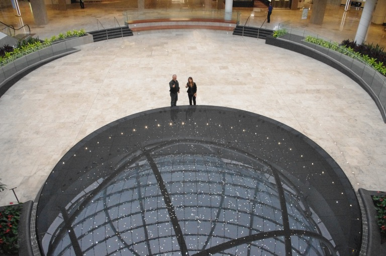 Eden Food For Change executive director Bill Crawford and Erin Mills Town Centre marketing director Francesca Bourré toss coins into the mall's new infinity fountain. Coins collected are going to benefit EFFC over the next year. (Photo: Eden Food for Change)