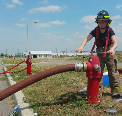 Abigail Ashley of Oakville works on a fire hydrant at Camp Ignite on Wednesday, Aug. 10, 2016. (Photo: Kelly Roche/QEW South Post)