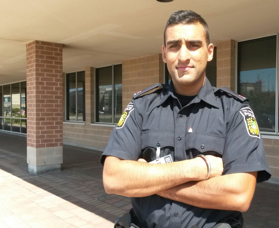 """Peel Police Recruit Constable Nima Lota, 25, is off to Ontario Police College for training next month. """"I was supposed to be a lawyer or doctor but it didn't work out,"""" he said, chuckling, during a training session at the Emil V. Kolb Centre on Tuesday, Aug. 30, 2016. (Photo: Kelly Roche/QEW South Post)"""