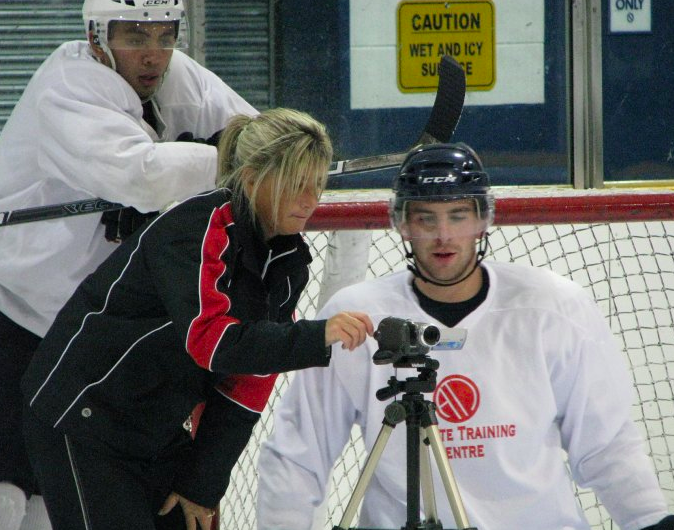 Renowned power skating coach Dawn Braid reviews footage with NHL star John Tavares (right) as Wes Clark looks on. (Photo: The Athlete Training Centre)