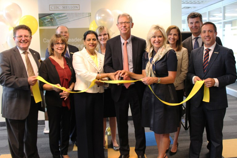 A ribbon-cutting ceremony took place during CIBC Mellon''s opening at its new Mississauga location at 55 Standish Court. (CNW Group/CIBC Mellon)