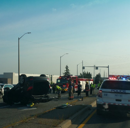 A black SUV flipped over at Erin Mills Pkwy. and Britannia Rd. on Friday, Aug. 5, 2016. A woman was arrested at the scene. (Photo: Peel Police)