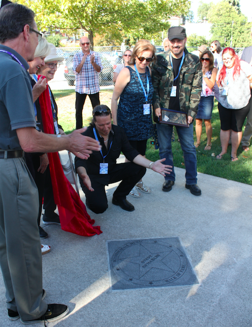 Steve DeMarchi, of Alias fame, unveils his star along the Mississauga Music Walk of Fame on Sunday, Sept. 11, 2016. He was one of four inductees honoured at the 5th annual event. (Photo: Emma Schatochin/QEW South Post)
