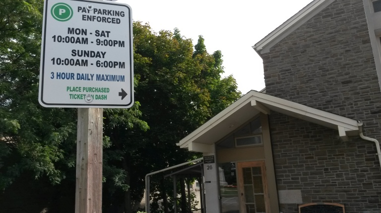 The City of Mississauga has replaced signs in Port Credit displaying new parking rates. (Photo: Kelly Roche/QEW South Post)