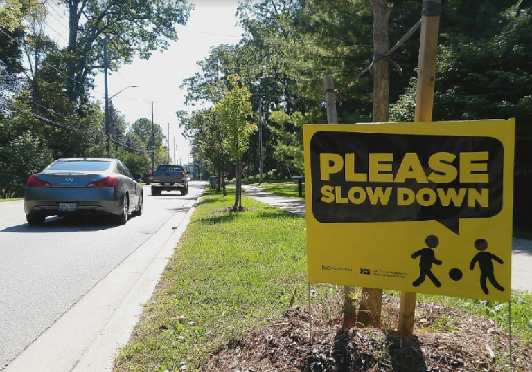 The City of Mississauga is encouraging drivers to slow down on streets to ensure safety of residents. A Please Slow Down sign is seen on Clarkson Rd. N. on Sept. 19, 2016. (Photo: Kelly Roche/QEW South Post)