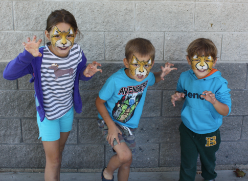 Port Credit residents Ella Tremblay, 7, and Oliver and Devin Tremblay, 5, show off their 'inner lions' at the Lakefront Promenade Marina BBQ on Saturday, Sept. 24, 2016. (Photo: Emma Schatochin/QEW South Post)