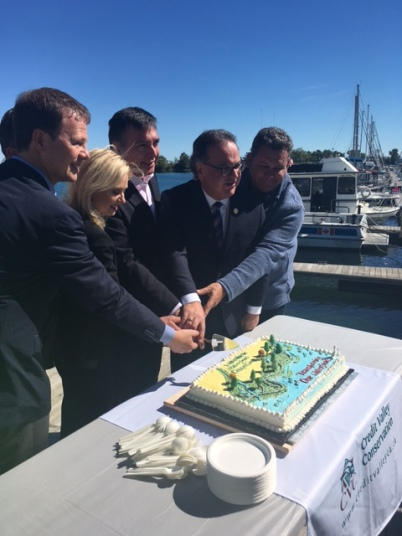 "Mississauga-Lakeshore MP Sven Spengemann, Mayor Bonnie Crombie, Mississauga South MPP Charles Sousa, Ward 1 Coun. Jim Tovey, and Toronto's Ward 6 Coun. Mark Grimes cut the cake at the ground making of the Lakeview Waterfront Connection on Saturday, Sept. 24, 2016. ""We want to put the 'view' back into Lakeview,"" said Crombie. (Photo: Emma Schatochin/QEW South Post)"