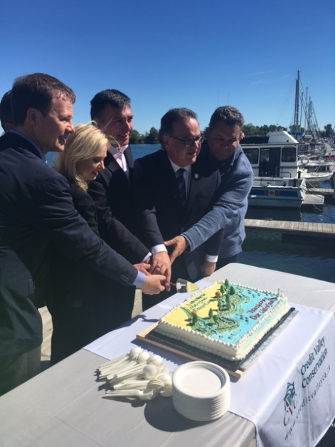"""Mississauga-Lakeshore MP Sven Spengemann, Mayor Bonnie Crombie, Mississauga South MPP Charles Sousa, Ward 1 Coun. Jim Tovey, and Toronto's Ward 6 Coun. Mark Grimes cut the cake at the ground making of the Lakeview Waterfront Connection on Saturday, Sept. 24, 2016. """"We want to put the 'view' back into Lakeview,"""" said Crombie. (Photo: Emma Schatochin/QEW South Post)"""