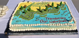 A cake depicting south Mississauga's waterfront transformation was cut by officials on Sept. 24 2016. The project will see 1.5 kms of new shoreline stretching from the old Lakeview generating station to the Toronto border at Marie Curtis Park. (Photo: Irene Owchar/QEW South Post)