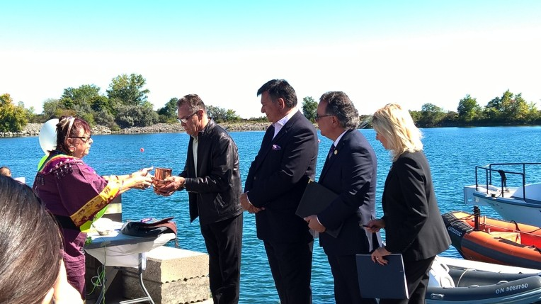 Valerie King of the Mississaugas of the New Credit First Nation performs a blessing of the waters with Ward 1 Coun. Jim Tovey, Mississauga-South MPP Charles Sousa, Ward 7 Coun. Nando Iannicca, and Mayor Bonnie Crombie. The blessing took place at the Lakeview Waterfront Connection celebration on Saturday, Sept. 24, 2016. (Photo: Irene Owchar/QEW South Post)