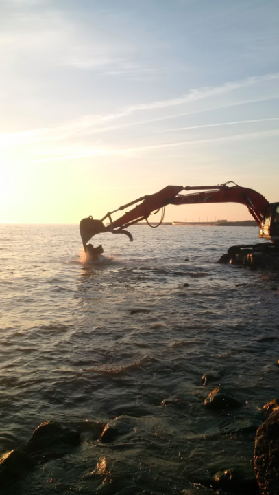 The first load of rubble is placed in Lake Ontario to restore Mississauga's shoreline and create a vibrant new waterfront conservation area. (Photo: Credit Valley Conservation)