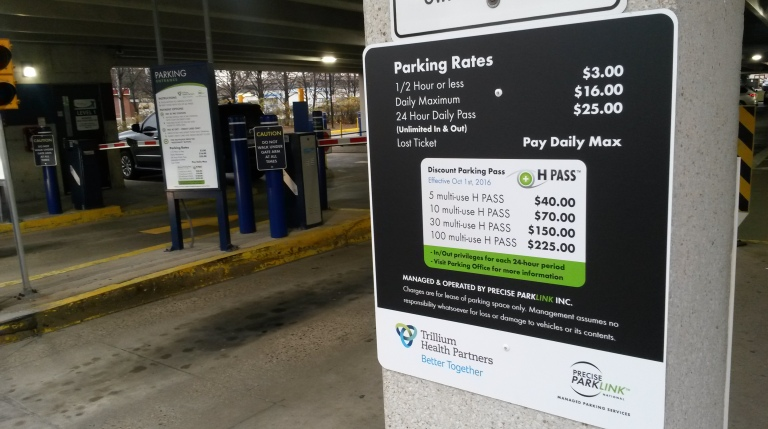 Parking rates are displayed at Trillium's Cooksville campus. (Photo: Kelly Roche/QEW South Post)