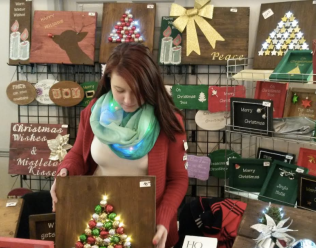 Kassidy LaRiviere sells items from LK D-Signs during the inaugural Cranberry Christmas Market at Clarke Hall in Port Credit on Saturday, Dec. 3, 2016. (Photo: Kelly Roche/QEW South Post)
