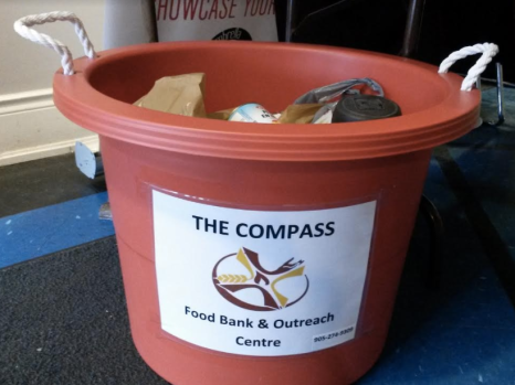 Canned goods were being collected for The Compass Food Bank during the inaugural Cranberry Christmas Market at Clarke Hall in Port Credit on Saturday, Dec. 3, 2016. (Photo: Kelly Roche/QEW South Post)
