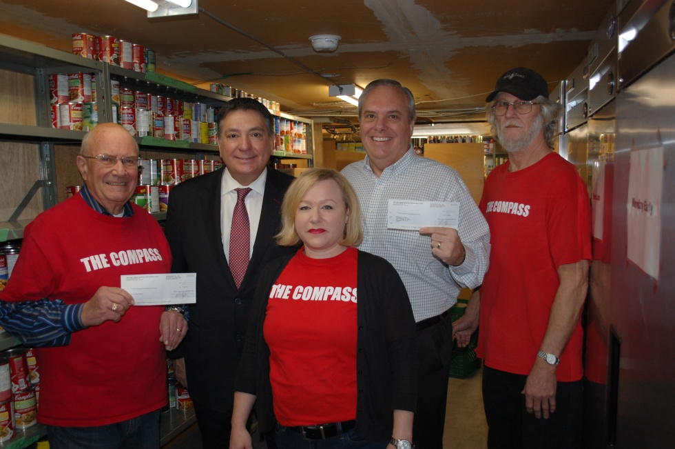L-R:  Pat Cullen (The Compass); Mississauga South MPP Charles Sousa; Trish Trapani (The Compass); Chris Hatch (The Mississauga Food Bank) and Earl Driver (The Compass) are photographed on Tuesday, Feb. 7, 2017. (Photo courtesy of Charles Sousa's office).
